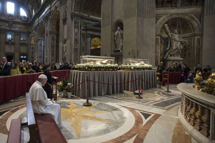 MISSIONARIES OF MERCY. Pope Francis prays in front of the coffins containing the exhumed bodies of Sts. Padre Pio and Leopold Mandic displayed in St. Peter's Basilica at the Vatican, Feb. 6 (CNS photo/L'Osservatore Romano via Reuters).