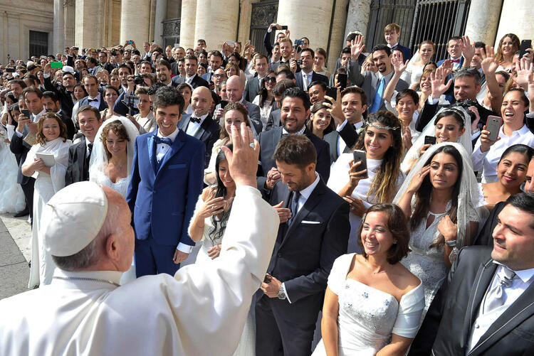 Pope Francis greets newly married couples during his general audience in St. Peter's Square at the Vatican in this Sept. 30, 2015, file photo.