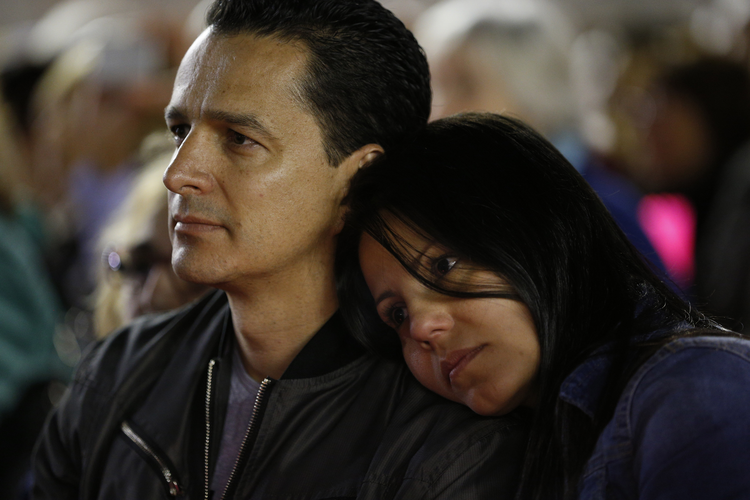 A couple attend a prayer vigil for the Synod of Bishops on the family in St. Peter's Square at the Vatican in this Oct. 3, 2015, file photo.