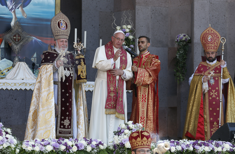 Pope Francis, accompanied by Catholicos Karekin II, patriarch of the Armenian Apostolic Church, gives his blessing at the conclusion of a divine liturgy at Etchmiadzin in Vagharshapat, Armenia, June 26 (CNS photo/Paul Haring).
