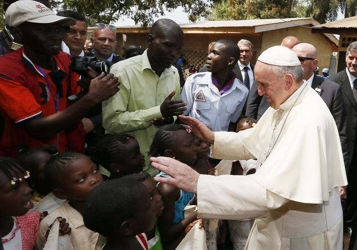 Pope Francis greets children as he visits a refugee camp in Bangui, Central African Republic, Nov. 29 (CNS photo/Paul Haring).