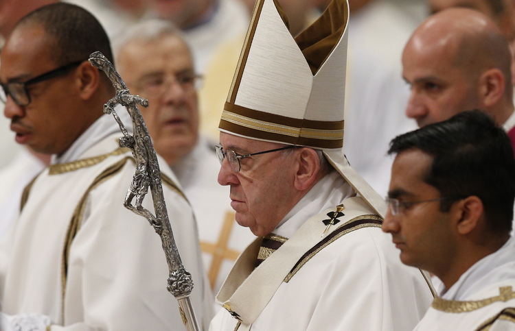 Pope Francis arrives to celebrate the Holy Thursday chrism Mass in St. Peter's Basilica at the Vatican, March 24 (CNS photo/Paul Haring).