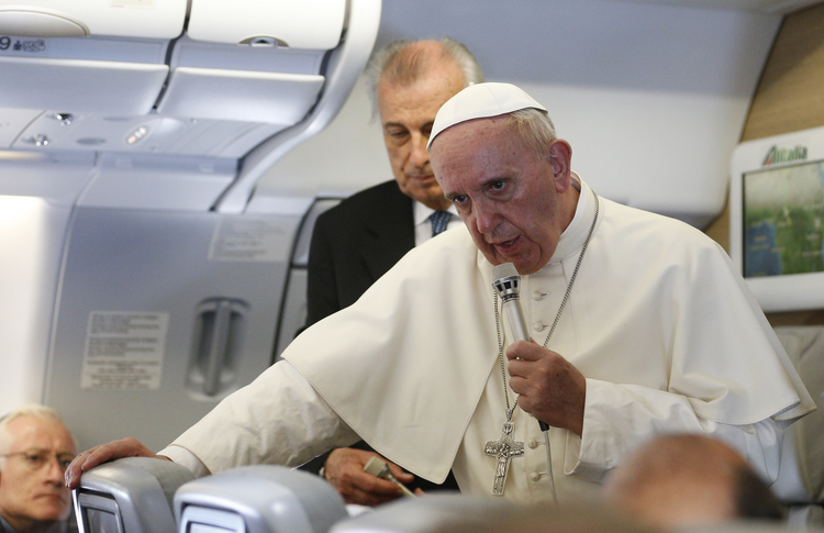 Pope Francis answers questions from journalists aboard his flight from Bangui, Central African Republic, to Rome Nov. 30 (CNS photo/Paul Haring).