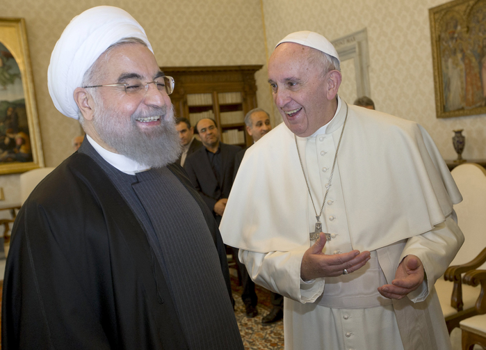 Pope Francis shares a light moment with Iranian President Hassan Rouhani during a private meeting at the Vatican Jan. 26 (CNS photo/Andrew Medichini, pool via Reuters).