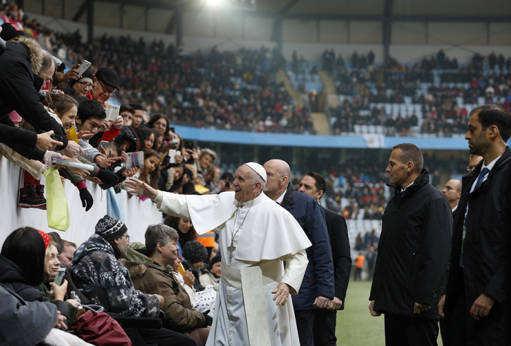 Pope Francis greets people before celebrating Mass at the Swedbank Stadium in Malmo, Sweden, Nov. 1 (CNS photo/Paul Haring).