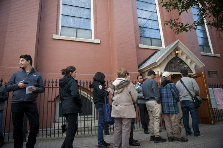 Voters wait outside a polling location for the presidential election Nov. 8 shortly after polls opened at Annunciation Church in Philadelphia. (CNS photo/Tracie Van Auken, EPA)