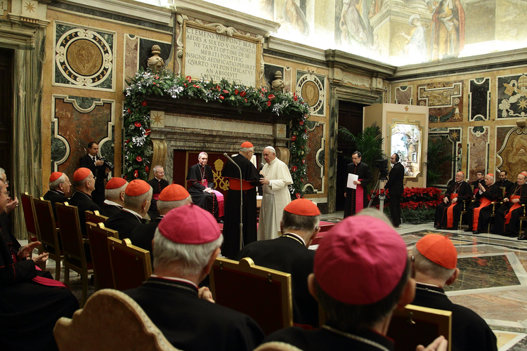 Pope Francis greets Cardinal Angelo Sodano, dean of the College of Cardinals, during the traditional Christmas greetings to the Roman Curia in the Clementine Hall of the Apostolic Palace at the Vatican, Dec. 21 (CNS photo/Evandro Inetti, pool).