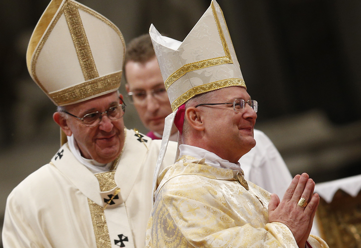 New Archbishop Peter B. Wells, a native of Tulsa, Oklahoma, right, smiles during his ordination to the episcopate by Pope Francis in St. Peter's Basilica at the Vatican, March 19.