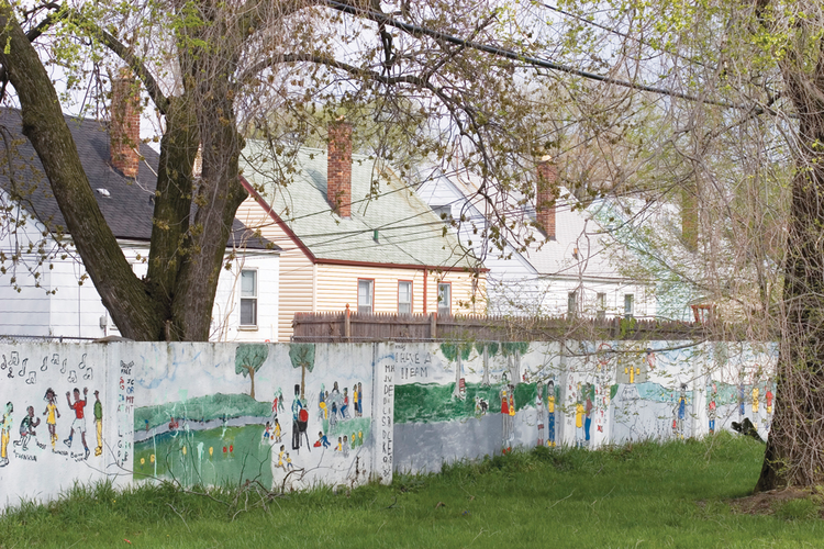 COLOR LINES. This wall, pictured in 2005, was built in the 1940s to enforce residential segregation in Detroit. The wall still stands, even though neighborhoods on both sides are now uniformly African-American.