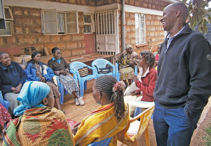 ROUNDTABLE: Stephen Nzioki, S.J., speaks with women being counseled and medically treated for H.I.V. through a Catholic program in Nairobi, Kenya.