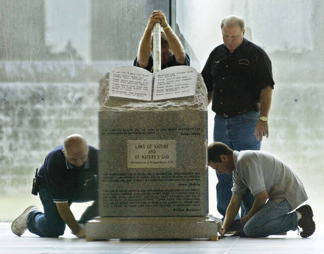 GOD-LESS: Workers remove a Ten Commandments monument from the Alabama Judicial Building in Montgomery in 2003.