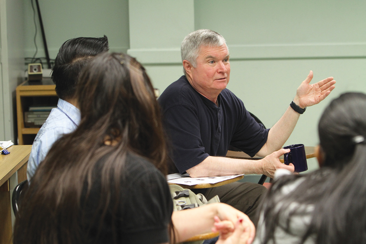 TAKING CHARGE. John Lundy leads a class in English as a Second Language as a member of the Ignatian Volunteer Corps, in the South Bronx section of New York City.