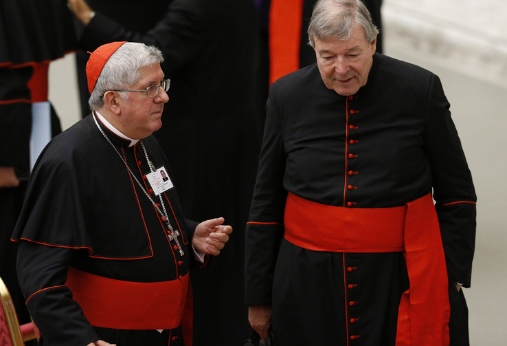 Cardinal Thomas Collins of Toronto and Australian Cardinal George Pell talk after an event marking the 50th anniversary of the Synod of Bishops in Paul VI hall at the Vatican, Oct. 17 (CNS Photo / Paul Haring).