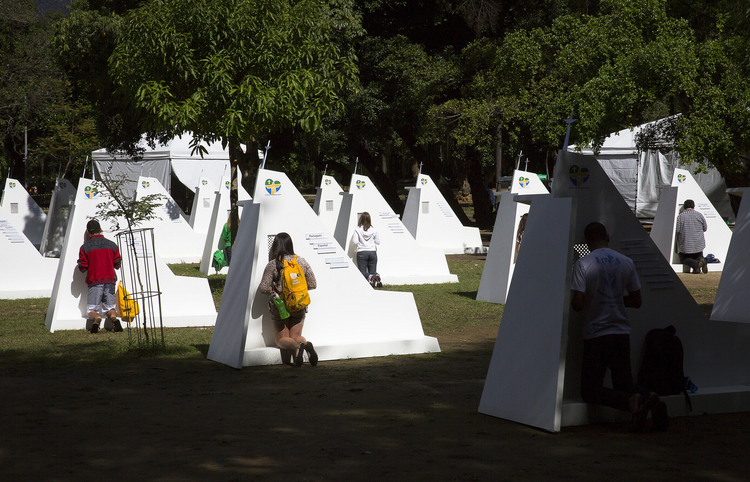 World Youth Day pilgrims take advantage of temporary confessionals set up at Rio park (CNS Photo/Tyler Orsburn).