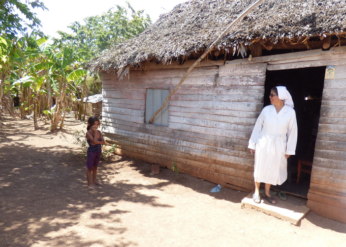 Sister Olga Arias visits a family of nine, including seven children, in early March in rural Cuba. It can be daunting to transmit the values of the church when families are focused on day-by-day survival, she said. (CNS photo/Rhina Guidos)