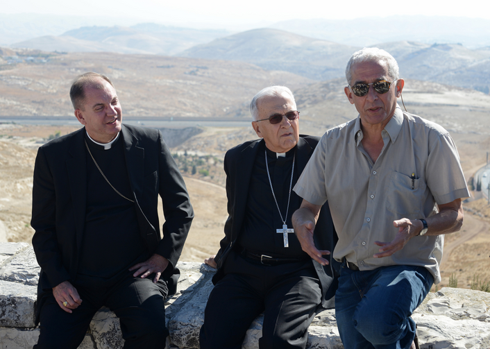 U.S. bishops listen as Israeli attorney gives explanation of land use around Jerusalem.