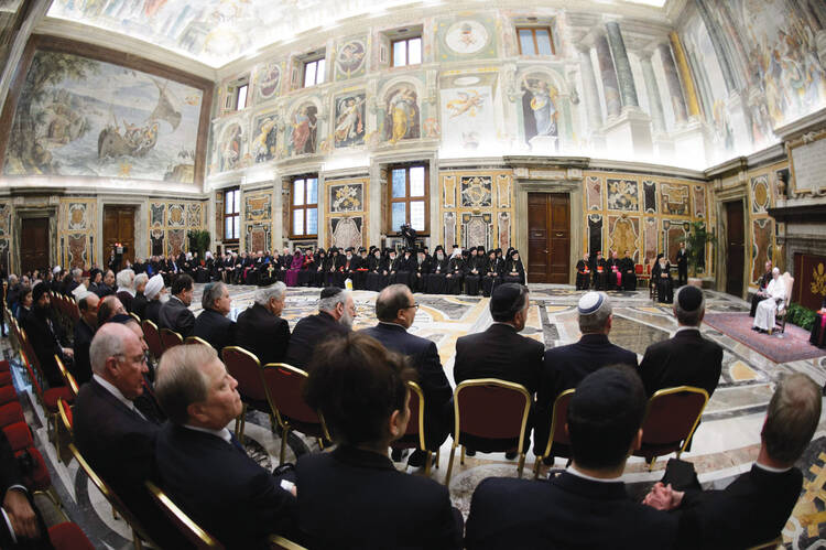 CONVERSATION STARTERS. Pope Francis leads a meeting with interfaith  religious leaders at the Vatican, March 20, 2013.