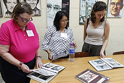Members of a U.S. delegation interested in learning about the Salvadoran martyrs look at pictures in the Archbishop Romero Center at Central American University in San Salvador July 24.