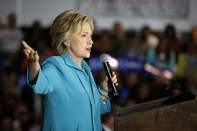 Hillary Clinton stands alone in promising to continue President Obama's steady course. (AP Photo/John Locher)