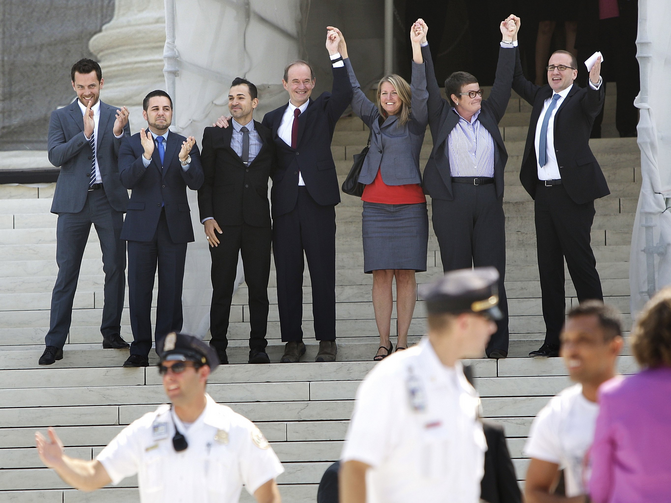 Attorney, plaintiffs in case against California's Proposition 8 celebrate supporters on steps of Supreme Court in Washington (CNS photo/Jonathan Ernst, Reuters)..