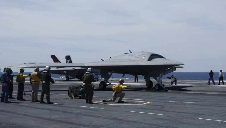 Crew prepares to launch pilot-less drone combat aircraft from aircraft carrier in Atlantic Ocean off coast of Virginia, May 21, 2013.