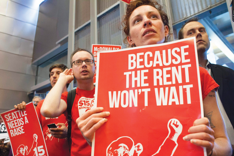 FIGHT FOR $15. Activists at a critical Seattle City Council meeting last June.