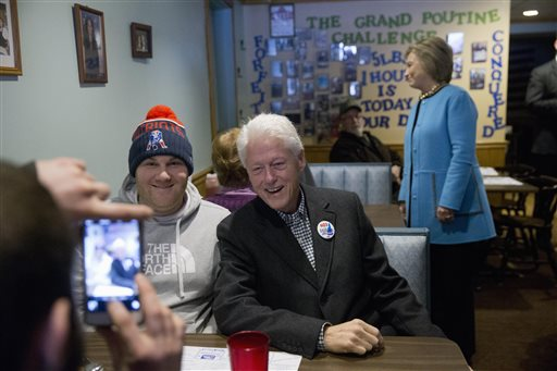 Former president Bill Clinton explains it all to young Democrats. (AP Photo/Matt Rourke)