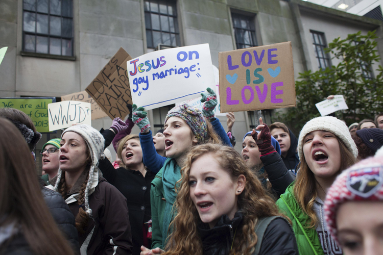 Eastside Catholic students rally in support of Mark Zmuda, the school's former vice principal, outside the chancery building of the Archdiocese of Seattle on Dec. 20. (CNS photo/David Ryder, Reuters)