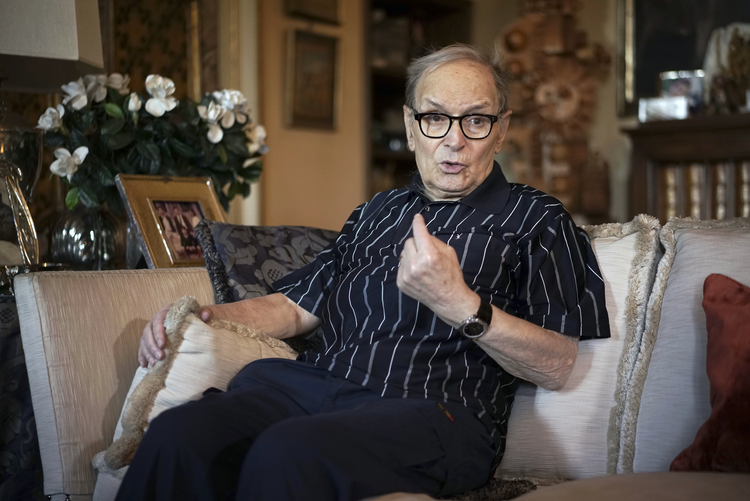 In this May 31, 2016 file photo, three-time best sound-track Oscar winner Ennio Morricone answers questions during an interview with The Associated Press, in Rome. Morricone died Monday, July 6, 2020 in a Rome hospital at the age of 91. (AP Photo/Andrew Medichini, file)
