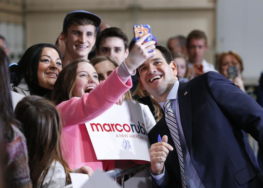 Republican presidential candidate, Sen. Marco Rubio, R-Fla., poses for a photograph at a campaign rally in Boise, Idaho, Sunday, March 6, 2016. (AP Photo/Paul Sancya)