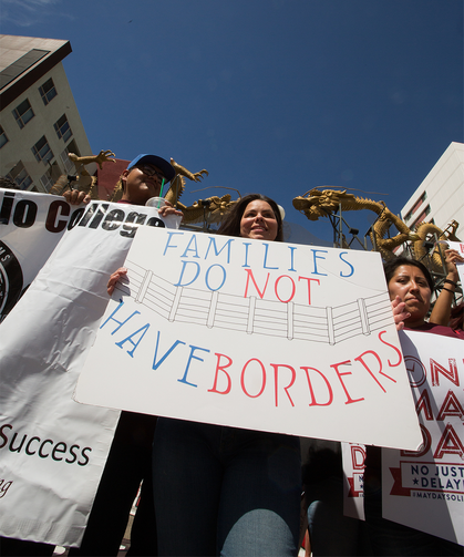 International Workers' Day supporters gather in downtown Los Angeles on May 1 to raise awareness about minimum wage and immigration issues (CNS photo/Victor Aleman, Vida-Nueva).