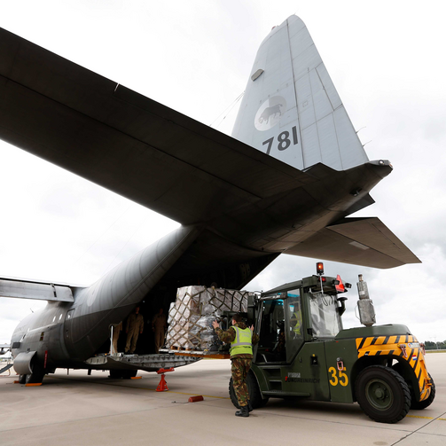 A transport aircraft at Eindhoven Airbase in Eindhoven, Netherlands, is loaded with relief supplies for victims of the humanitarian disaster in Iraq, Aug. 2014 (CNS photo/Bas Czerwinski, EPA).