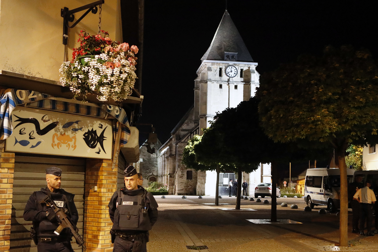French riot police guards the street to access the church where an hostage taking left a priest dead in Saint-Etienne-du-Rouvray, Normandy, France on July 26. (AP Photo/Francois Mori)