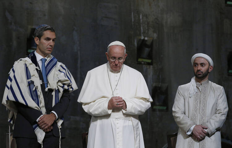 Pope Francis stands between Jewish and Muslim religious leaders during a prayer service at the ground zero 9/11 Memorial Museum in New York, Sept. 25 (CNS Photo / Paul Haring)..