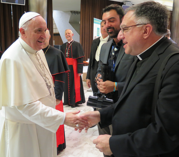 Pope Francis and Fr. Rosica, with Cardinal Donald Wuerl in the background.