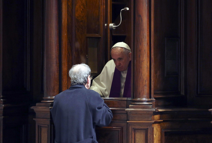 Pope Francis hears confession during a penitential liturgy in early March in St. Peter's Basilica (CNS photo/Alessandro Bianchi pool via EPA).