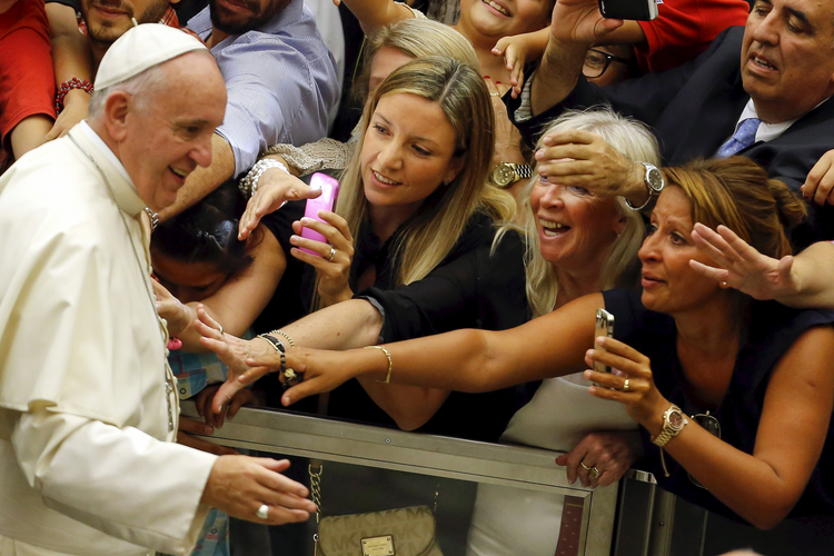Pope Francis arrives to lead his weekly audience in Paul VI hall at the Vatican Aug. 5. (CNS photo/Giampiero Sposito, Reuters)