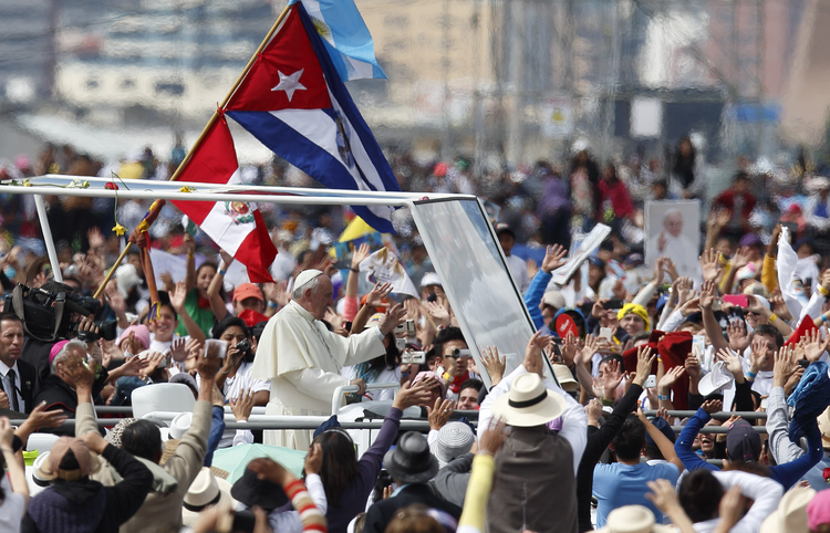 Pope Francis greets the crowd as he arrives to celebrate Mass in Bicentennial Park in Quito, Ecuador, July 7. (CNS photo/Paul Haring)