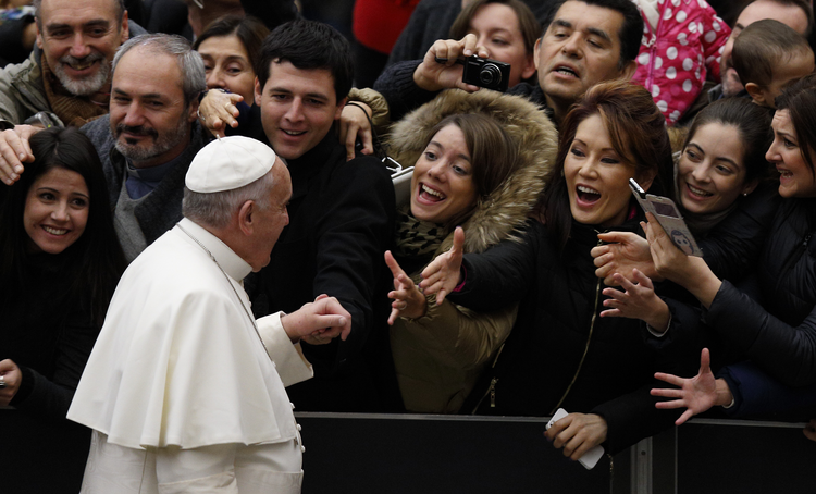 Pope Francis arrives to lead his general audience in Paul VI hall at the Vatican Jan. 7. (CNS photo/Paul Haring)