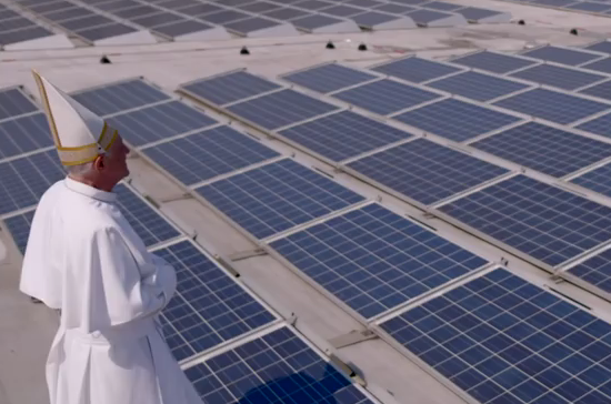 "An actor playing Pope Francis blesses an array of solar panels in the satirical online video ""Pope Francis: The Encyclical."""