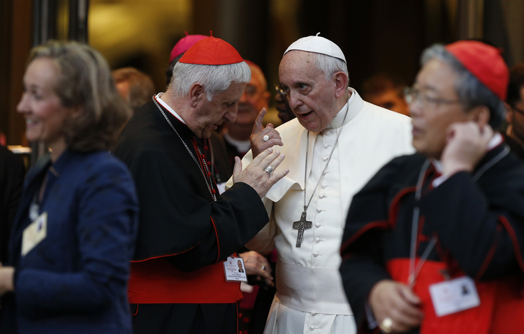 Pope Francis talks with Italian Cardinal Giuseppe Versaldi as they leave the concluding session of the extraordinary Synod of Bishops on the family at the Vatican Oct. 18. (CNS photo/Paul Haring)