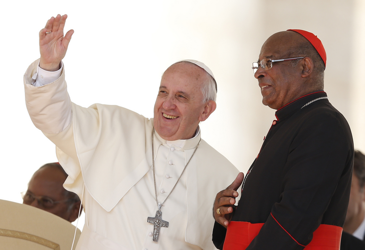 Pope waves to pilgrims from South Africa during general audience in St. Peter's Square, Sept. 25 (CNS Photo / Paul Haring).