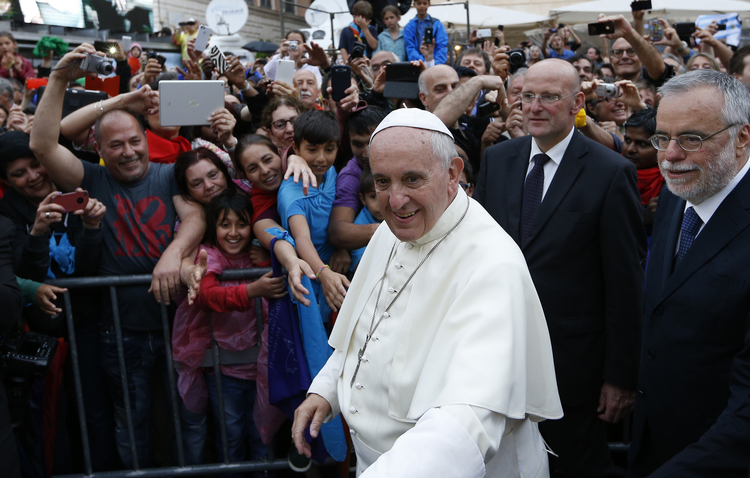 Pope Francis greets the crowd as he arrives to visit the Basilica of Santa Maria in Rome's Trastevere neighborhood on June 15. The pope visited members of the Community of Sant'Egidio.