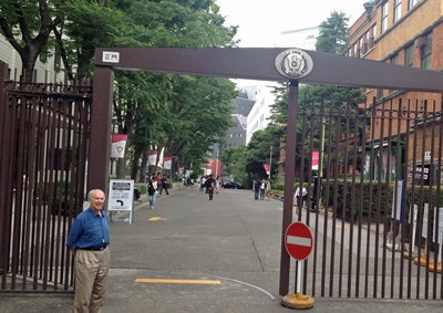 Fr. Bill Currie SJ at the entrance to the Sophia University in Japan