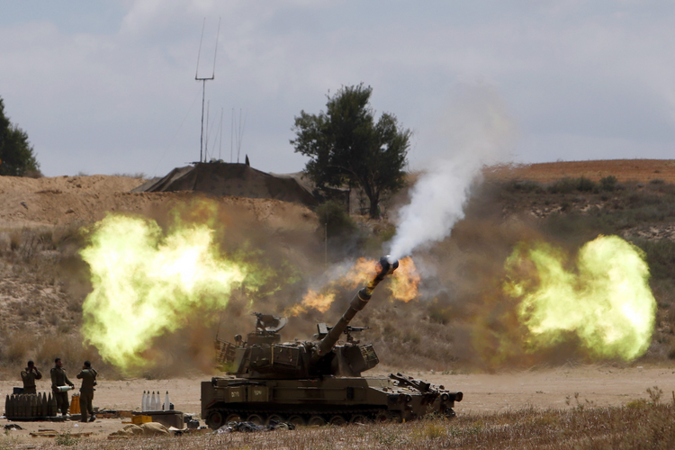 An Israeli mobile artillery unit fires toward the Gaza Strip July 18. Pope Francis telephoned Israeli President Shimon Peres and Palestinian President Mahmoud Abbas on July 18, urging all sides to end hostilities and build peace.