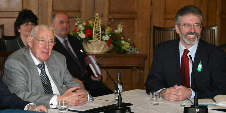Democratic Unionist Party leader Ian Paisley, left, and Sinn Fein leader Gerry Adams, right, address a news conference after the main Protestant and Catholic parties agreed to start sharing power, May 8, 2007.
