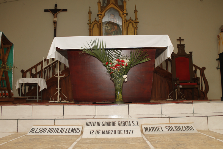 The tombs of Father Rutilio Grande, Manuel Solorzano and Nelson Lemus are seen inside a church in El Paisnal, El Salvador. (CNS photo/ Edgardo Ayala)