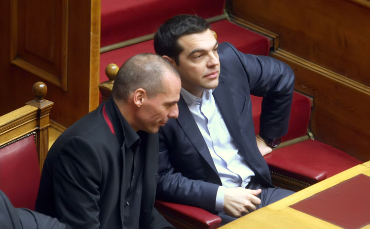 Prime Minister Alexis Tsipras, right, talks with Finance Minister Yanis Varoufakis at the Greek Parliament, Feb. 18.