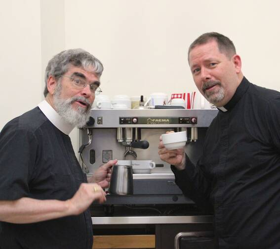 Brother Guy Consolmagno, S.J., and Father Paul Mueller, S.J. at the Vatican Observatory coffee machine. (photo provided)