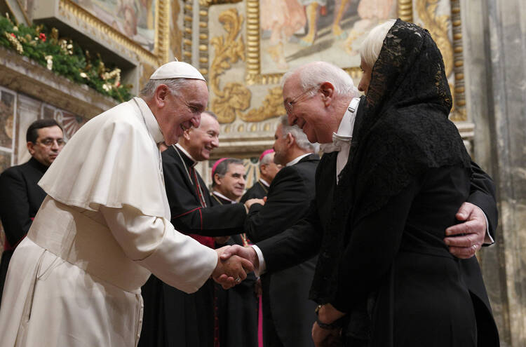 Pope Francis exchanges greetings with Ken Hackett, U.S. ambassador to the Holy See, and his wife, Joan, during a meeting with ambassadors to the Holy See at the Vatican, Jan. 13, 2014 (CNS photo/Paul Haring).